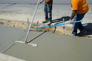 Workers laying concrete for a foundation in Denton